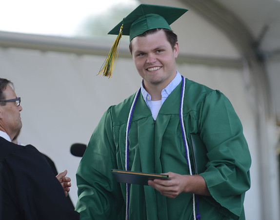 HALEY WARD   THE GOSHEN NEWS<br /> Eric Wentworth receives his and his brother's diploma from Board President David Black during Northridge High School's Commencement on Sunday.