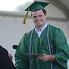 HALEY WARD | THE GOSHEN NEWS<br /> Eric Wentworth receives his and his brother's diploma from Board President David Black during Northridge High School's Commencement on Sunday.