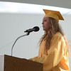 HALEY WARD | THE GOSHEN NEWS<br /> Class Co-Vice President Zoie Ann Peterson says a prayer during Northridge High School's Commencement on Sunday.