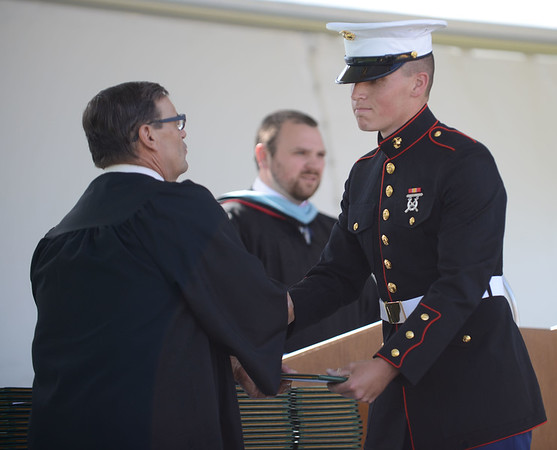 HALEY WARD   THE GOSHEN NEWS<br /> Alexander Bernth receives his diploma from Board President David Black during Northridge High School's Commencement on Sunday.