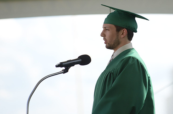 HALEY WARD | THE GOSHEN NEWS<br /> Seth Ray Cripe gives the student address during Northridge High School's Commencement on Sunday.
