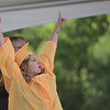 HALEY WARD | THE GOSHEN NEWS<br /> Ivy Morris celebrates while receiving her diploma during Northridge High School's Commencement on Sunday.
