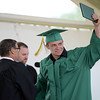 HALEY WARD | THE GOSHEN NEWS<br /> Brandon Nixon receives his diploma from Board President David Black during Northridge High School's Commencement on Sunday.