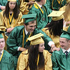 JULIE CROTHERS BEER | THE GOSHEN NEWS<br /> Caleb Heinisch, a graduate of the Wawasee High School class of 2016, grabs his friend on the shoulder after turning the tassel on his graduation cap Sunday at the high school.