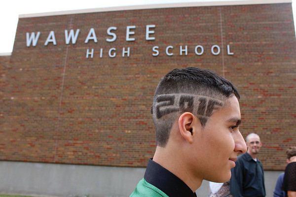 JULIE CROTHERS BEER | THE GOSHEN NEWS<br /> Ivan Sanchez, a 2016 graduate of Wawasee High School, shaved his head in celebration of graduation Sunday at the school.