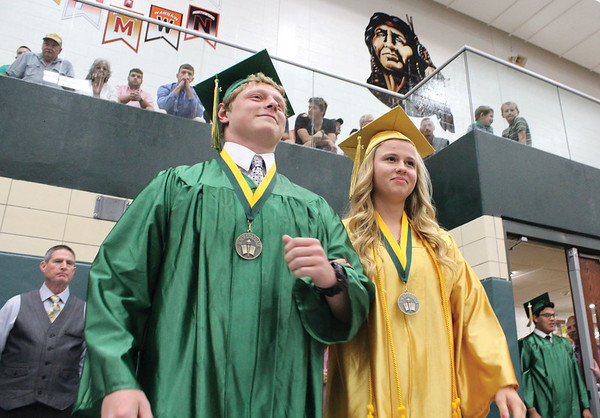 JULIE CROTHERS BEER | THE GOSHEN NEWS<br /> Wawasee High School graduates Stephen Possell and Kylee Rostochak walk into the gymnasium Sunday as the commencement ceremony begins.
