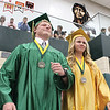 JULIE CROTHERS BEER   THE GOSHEN NEWS<br /> Wawasee High School graduates Stephen Possell and Kylee Rostochak walk into the gymnasium Sunday as the commencement ceremony begins.