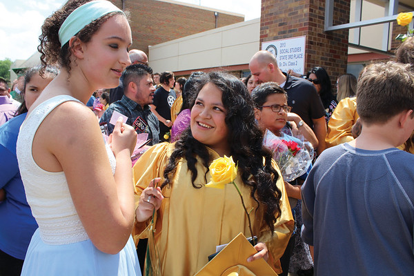 JULIE CROTHERS BEER   THE GOSHEN NEWS<br /> Jessica Garcia, a 2016 graduate of Wawasee High School, greets friends and family outside the school after Sunday's commencement ceremony.