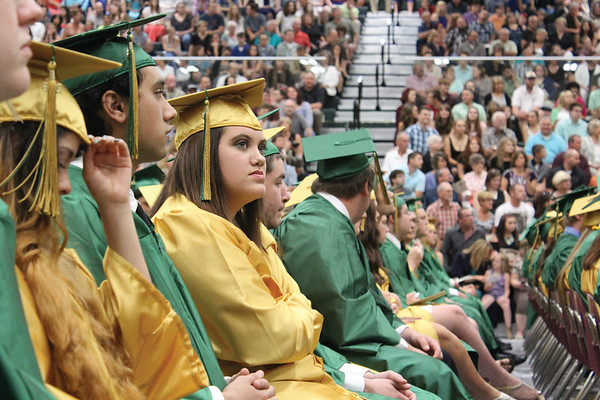 JULIE CROTHERS BEER | THE GOSHEN NEWS<br /> Abigail Schmucker, a member of the Wawasee High School class of 2016, listens during one of the speeches Sunday at commecement.