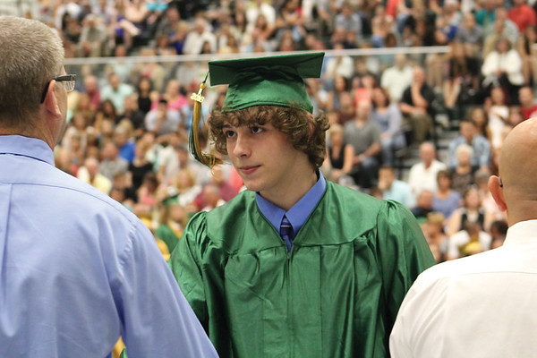 JULIE CROTHERS BEER   THE GOSHEN NEWS<br /> Trevor Kitson, a member of the Wawasee High School class of 2016, shakes hands with school board members after walking across the stage during commencement.