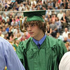 JULIE CROTHERS BEER | THE GOSHEN NEWS<br /> Trevor Kitson, a member of the Wawasee High School class of 2016, shakes hands with school board members after walking across the stage during commencement.