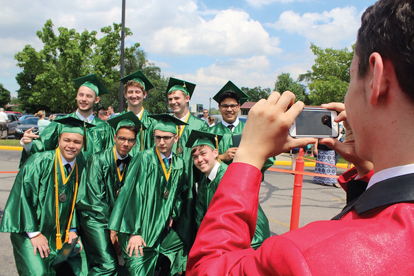 JULIE CROTHERS BEER | THE GOSHEN NEWS<br /> A group of Wawasee High School graduates pose for a photo outside the school Sunday after commencement.