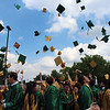 JULIE CROTHERS BEER | THE GOSHEN NEWS<br /> Wawasee High School graduates celebrate Sunday by tossing their graduation hats into the air after the commencement ceremony.