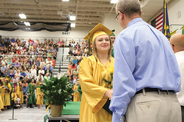 JULIE CROTHERS BEER | THE GOSHEN NEWS<br /> Allyson Weaver, a member of the Wawasee High School class of 2016, shakes the hand of a school board member Sunday after walking across the stage during commencement.