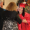 JOHN KLINE | THE GOSHEN NEWS<br /> West Noble High School graduate Cloe Griffith smiles after receiving her diploma during the school's graduation ceremony Sunday.
