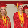 JOHN KLINE | THE GOSHEN NEWS<br /> West Noble High School Co-Valedictorians Megan Roy, left, and Samantha Grace Ness smile while being recognized for their academic achievements during the school's graduation ceremony Sunday afternoon.