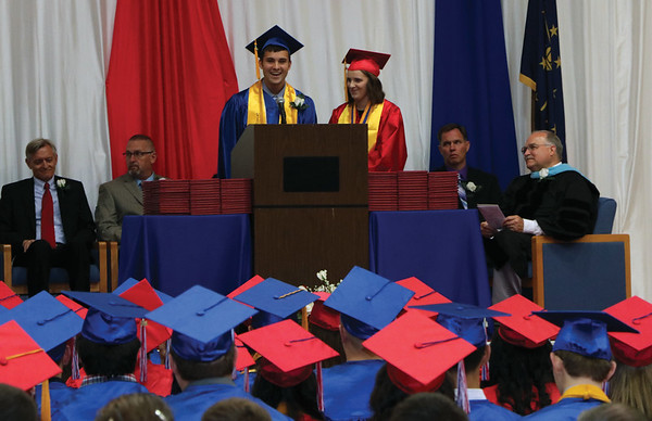 JOHN KLINE | THE GOSHEN NEWS<br /> West Noble High School Senior Co-Vice President Zachary Becker, center left, and Senior Class President Brooklyn Stanley, center right, provide the commencement address during the school's graduation ceremony Sunday.