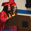 JOHN KLINE | THE GOSHEN NEWS<br /> West Noble High School Senior Class Secretary Crystal Marie Herrera Haro, left, and Senior Class Treasurer Jazmin Herrera provide the closing speech during graduation ceremonies at the school Sunday afternoon.