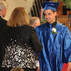 JOHN KLINE | THE GOSHEN NEWS<br /> West Noble High School graduating senior Gage Weaver is congratulated by a school board member after receiving his diploma Sunday afternoon in the school gym.
