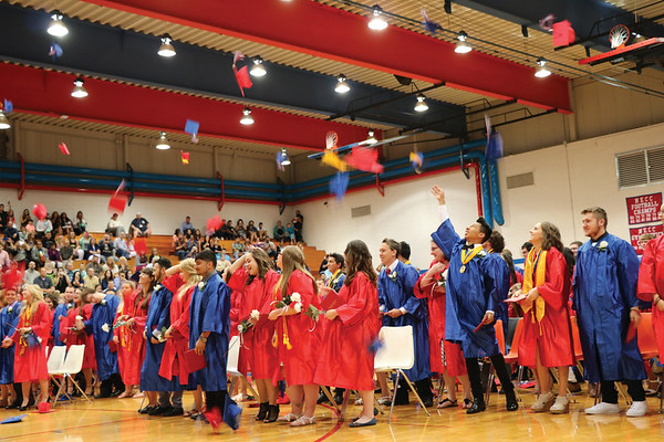 JOHN KLINE | THE GOSHEN NEWS<br /> Members of the West Noble High School class of 2016 toss their graduation caps in the air following the conclusion of their commencement ceremony Sunday afternoon in the school gym.