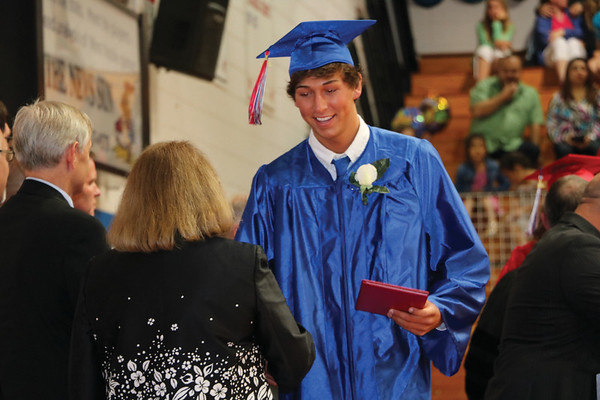 JOHN KLINE | THE GOSHEN NEWS<br /> West Noble High School senior Ryan Kendall shakes hands with a school board member after receiving his diploma Sunday afternoon in the school gym.