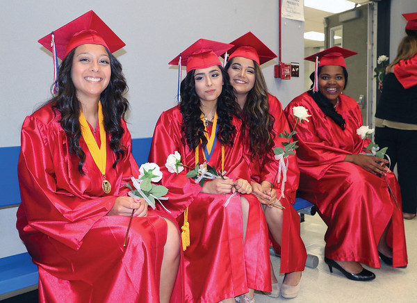 JOHN KLINE | THE GOSHEN NEWS<br /> West Noble High School seniors, from left, Diana Ramirez, Melissa Reyez, Sandra Carrillo and Madison Shrock get in some friend time before heading to the gym for the school's 2016 commencement ceremony Sunday afternoon.