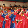 JOHN KLINE | THE GOSHEN NEWS<br /> Members of the West Noble High School class of 2016 perform the traditional turning of the tassel during commencement Sunday afternoon.