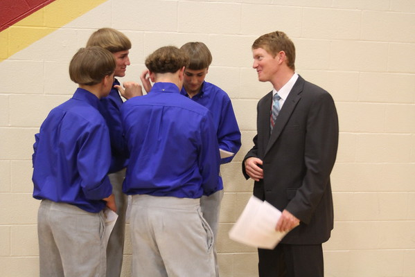 JULIE CROTHERS BEER | THE GOSHEN NEWS<br /> A group of Westview Jr-Sr High School eighth-grade students share a laugh with junior high principal Randy Miller after Friday's eighth-grade promotion and junior high awards ceremony in the school's gymnasium. School leaders honored 171 eighth-grade graduates Friday, nearly half of which will not return to high school in the fall due to their religious beliefs.
