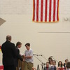 JULIE CROTHERS BEER | THE GOSHEN NEWS<br /> Westview Jr-Sr High School eighth-grade student Jamison Garcia receives his certificate from junior high school principal Randy Miller during Friday's eighth-grade promotion ceremony in the school's gymnasium.