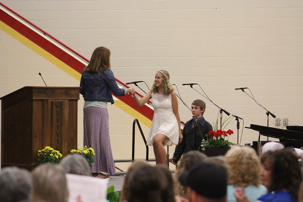JULIE CROTHERS BEER | THE GOSHEN NEWS<br /> Westview Jr-Sr High School eighth-grade student Lindsay Stoltzfus receives an award during Friday's eighth-grade promotion ceremony in the school's gymnasium.