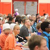 JULIE CROTHERS BEER | THE GOSHEN NEWS<br /> Westview Jr-Sr High School eighth-grader Amy Swartzendruber listens and watches as her classmates earn awards during the eighth-grade promotion and junior high awards ceremony Friday in the school's gymnasium.