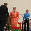 JULIE CROTHERS BEER | THE GOSHEN NEWS<br /> Westview Jr-Sr High School eighth-grade student Lanita Eash shakes hands with school adminsitrators after receiving her eighth-grade completion certificate during Friday's eighth-grade promotion ceremony in the school's gymnasium.