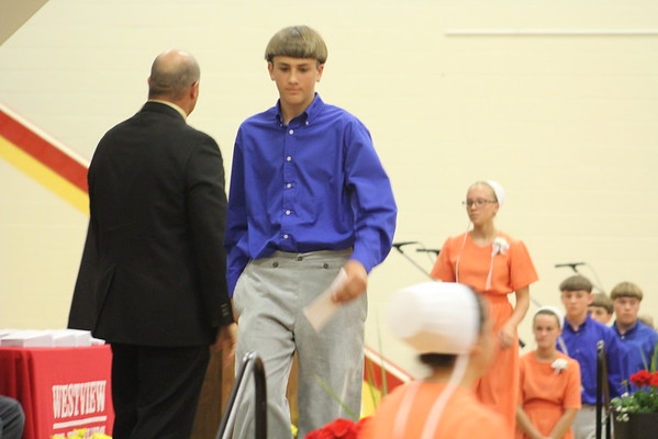 JULIE CROTHERS BEER   THE GOSHEN NEWS<br /> Westview Jr-Sr High School eighth-grade student Austin Fry walks off the stage after receiving his certificate from junior high school principal Randy Miller during Friday's eighth-grade promotion ceremony in the school's gymnasium.