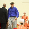 JULIE CROTHERS BEER | THE GOSHEN NEWS<br /> Westview Jr-Sr High School eighth-grade student Austin Fry walks off the stage after receiving his certificate from junior high school principal Randy Miller during Friday's eighth-grade promotion ceremony in the school's gymnasium.