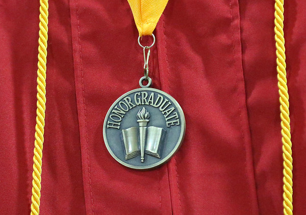 JAY YOUNG | THE GOSHEN NEWS<br /> An honors medal hangs from the gown of a Goshen High School graduating senior during the 2017 Commencement ceremony Sunday afternoon.