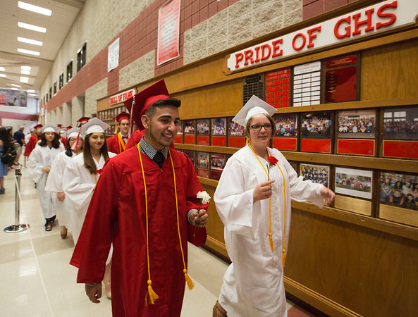 JAY YOUNG | THE GOSHEN NEWS<br /> A procession of Goshen High School graduating seniors makes its way through the hallways towards the gymnasium to start the 2017 Commencement ceremony Sunday afternoon.