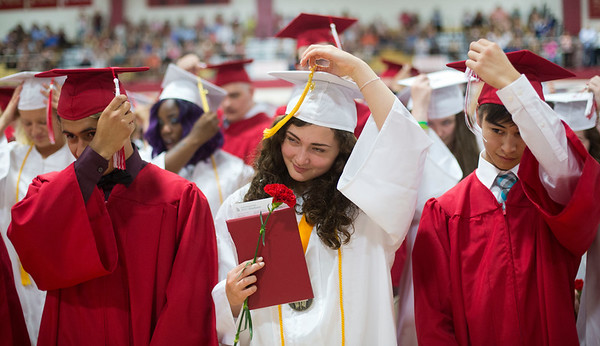 JAY YOUNG | THE GOSHEN NEWS<br /> Goshen High School graduating seniors, from left, Kevin Arellano, Katarina Antal and Matthew Ankrom turn their tassels to the left signifying the end of the graduation ceremony and their high school careers during the 2017 Commencement ceremony Sunday afternoon.