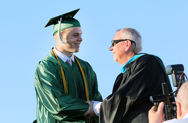 JOHN KLINE | THE GOSHEN NEWS <br /> Concord High School senior Brandon Alley, left, shakes hands with Concord High School Principal Greg Dettinger after accepting his diploma during the 2017 commencement ceremony at the high school Thursday evening. There were a total of 366 graduates in Concord's 2017 graduating class. Named as Valedictorian for the class of 2017 was Lauren Boone. Allyse Smith was named Salutatorian. Serving as the invited faculty speaker at this year's graduation ceremony was Concord High School Social Studies teacher Dan Ross.
