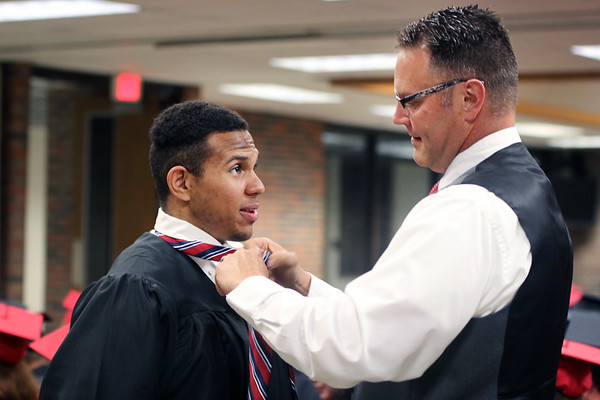 JULIE CROTHERS BEER | THE GOSHEN NEWS<br /> NorthWood High School Principal David Maugel ties a tie for graduating senior Michael Leonard before commencement began Friday at the school.