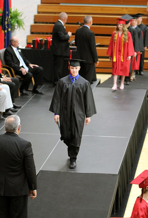 JULIE CROTHERS BEER | THE GOSHEN NEWS<br /> NorthWood High School senior Christopher Frye walks across the stage after receiving his diploma Friday night.