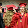 JULIE CROTHERS BEER | THE GOSHEN NEWS<br /> NorthWood High School classmates, from left, Jonathan Daubner, Madison Kuhn and Sarah Foster share a laugh before commencement Friday at the school.