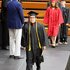JULIE CROTHERS BEER | THE GOSHEN NEWS<br /> NorthWood High School senior Pedro Antonio Trujillo walks across the stage after receiving his diploma Friday night.
