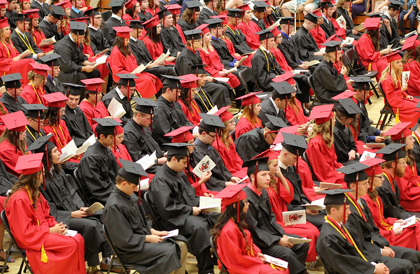 JULIE CROTHERS BEER   THE GOSHEN NEWS<br /> Rows of NorthWood High School seniors wait to cross the stage during the graduation ceremony Friday at the school.