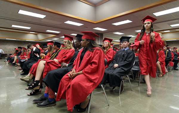 JULIE CROTHERS BEER | THE GOSHEN NEWS<br /> NorthWood High School graduating senior Hannah Simon steps forward from her seat to receive her cords as she and her classmates prepare for commencement Friday night.