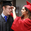 JULIE CROTHERS BEER | THE GOSHEN NEWS<br /> Kiara Guillen, at right, adjusts the cap of Sean Fisher as the two prepare for commencement Friday at NorthWood High School.