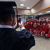 JULIE CROTHERS BEER | THE GOSHEN NEWS<br /> Vincent Herschberger takes a photo of a group of his classmates Friday night before commencement at NorthWood High School.