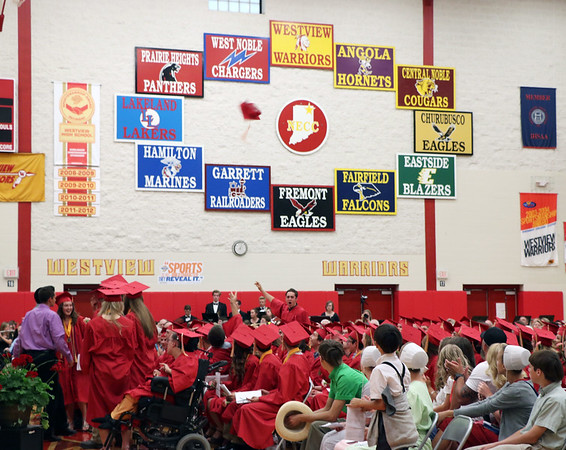 SHERRY VAN ARSDALL   THE GOSHEN NEWS One 2017 Westview senior tosses his cap in the air among the 87 graduates during the 51st commencement ceremony at Westview Jr-Sr High School in Topeka Thursday.