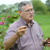 HALEY WARD | THE GOSHEN NEWS<br /> Bill Weybright talks to a group of a Benton Elementary second graders about his sunflowers during field trip Thursday at the garden at Greencroft Communities.