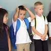 JULIE CROTHERS | THE GOSHEN NEWS<br /> Kindergartener Sophia Castillo and her classmates Christian Lopez and Talan Mason, all 5, wait for their parents to arrive after the first day of school Thursday at St. John the Evangelist Catholic School.