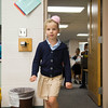 SAM HOUSEHOLDER | THE GOSHEN NEWS<br /> Raina Arbogast walks into her first grade glass Thursday at West Goshen Elementary School. The school has a dress code for the new school year, which Arbogast is wearing.